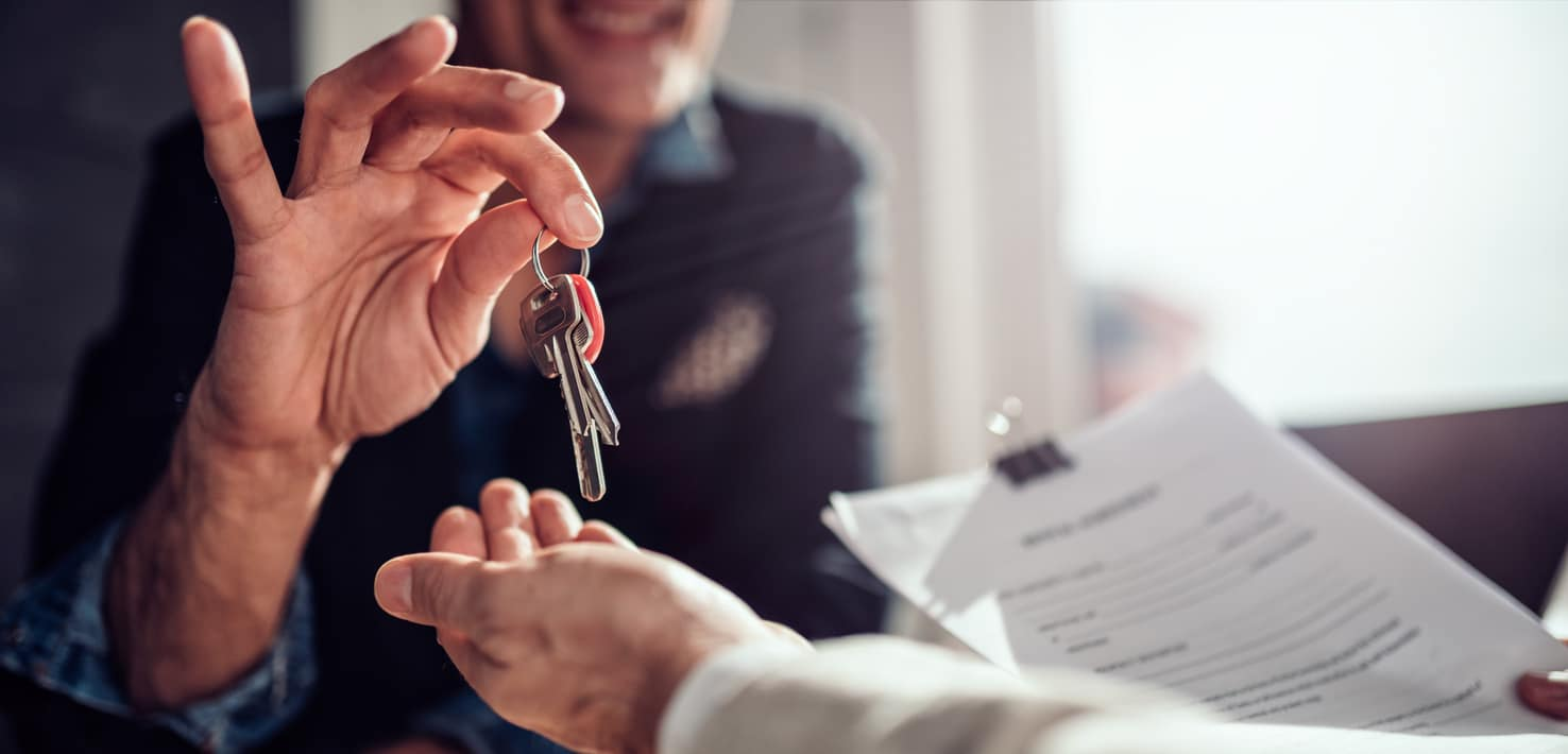 Landlord passing keys to his tenant